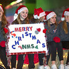North Middle School students offer their holiday tidings from their float during the 2016 Joplin Christmas Parade on Tuesday in downtown Joplin.<br /> Globe | Laurie Sisk