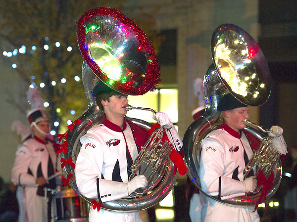 Members of the Joplin High School Marching Band entertain the crowd during the 2016 Joplin Christmas Parade on Tuesday in downtown Joplin.<br /> Globe | Laurie Sisk