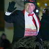 Joplin Christmas Parade Grand Marshall, Dr. Derek Miller, waves to the crowd at the start of the 46th annual parade on Tuesday in downtown Joplin.<br /> Globe | Laurie Sisk