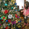 Eight-year-old DeLaney Dixon gets an up close look at the ornately decorated tree in the Caroline and Dennis Dixon home during the Carthage Historic Preservations' Christmas Homes Tour on Saturday. Despite sharing a surname, DeLaney is not related to the homeowners, who were one of six families to open their home to the tour.<br /> Globe | Laurie Sisk
