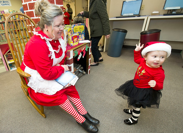 A delighted two-year-old Adelynn Overstreet gets acquainted with Mrs. Claus (aka Joplin Public Library's Children's Librarian Tammie Benham) during a special Holiday storytime on Tuesday at the library. Children were treated to snacks, arts and crafts, sing-a-longs and a reading of three Holiday-themed books.<br /> Globe | Laurie Sisk