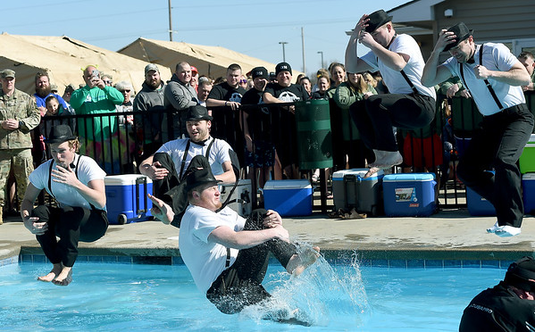 From the left: Frontenac firefighters Luke Loy, Rya Long, AJ Lusker, Ryan Hemby and Johnny Zafuta take the frigid plunge into the Crimson Villa Pool in Pittsburg during the Polar Plunge to benefit Special Olympics on Saturday.<br /> Globe | Laurie Sisk