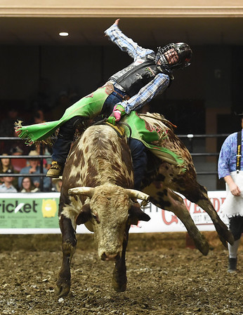 "Dalton Krantz, of Otho Iowa, opens the competition with a successful ride on ""Twisted Style"" during the LJ Jenkins Bull Riding Tour Finals on Saturday night at Memorial Hall.<br /> Globe 