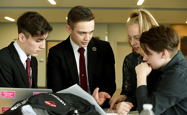 From the left: Aurora High School debaters Zac Grant, Matthew Atwood, Mette Geerling and Jaden Halloway map out their strategy for the Public Forum Debate on Saturday during the Joplin High School Speech and Debate Tournament at the JHS Performing Arts Center. Geerling is a foreign exchange student from the Netherlands.<br /> Globe | Laurie SIsk