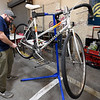 Zach Gagnon works on a french-made Peugeot bicycle on Saturday at the Empire Market. Gagnon is part of th Pedal it Forward program, which refurbishes used bicycles for those in need.<br /> Globe | LAurie Sisk
