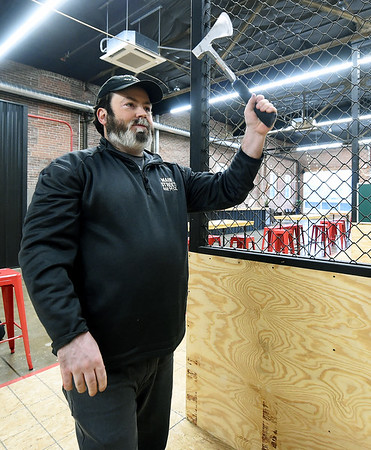 Main Street Axe Co. co-owner Ben Fowler prepares to throw an axe at his business on Wednesday.<br /> Globe   Laurie SIsk