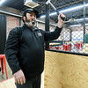 Main Street Axe Co. co-owner Ben Fowler prepares to throw an axe at his business on Wednesday.<br /> Globe | Laurie SIsk