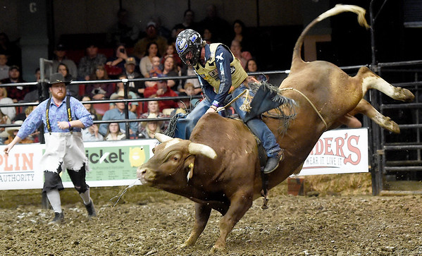 """Cody Rodeo Tyler, of  Perry Okla., tries to stay atop """"Modified Hou"""" during the LJ Jenkins Bull Riding Tour Finals on Saturday night at Memorial Hall.<br /> Globe 