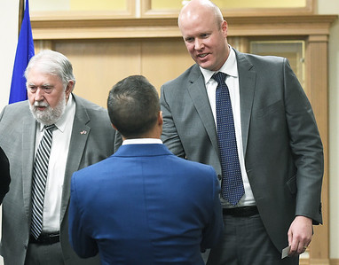 Joplin's new City Manager Nick Edwardsgreets Mike Landis a press conference on Wednesday at Joplin City Hall. Also pictured is Joplin Mayor Gary Shaw Globe   Laurie Sisk