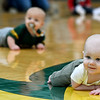 Seven month old Hudson Tupman, front, races to a first place finish as 10-month-old Rex Doak tries to narrow the gap during the Diaper Dash at halftime of the Missouri Southern/Rogers State basketball game on Saturday at Leggett & Platt.<br /> Globe | Laurie Sisk