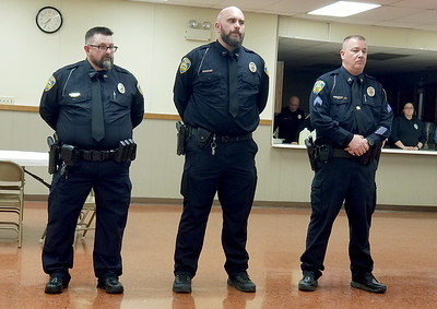 From the left:  Baxter Spring Police Officers Jimmy Hamilton, Justin Butler and Darryl Nadeau, who were injured while on duty in 2017, were honored Tuesday for their heroism and bravery in attempting to save the life of 65-year-old Sharon Horn.  Kimberly Barker   Joplin Globe