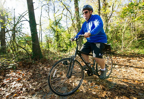 Garry Smith, of Baxter Springs, rides the Ruby Trail near Carthage on Thursday. Officials with the Joplin Trails Coalition are planning a 1.5 mile expansion of the trail.<br /> Globe   Laurie Sisk