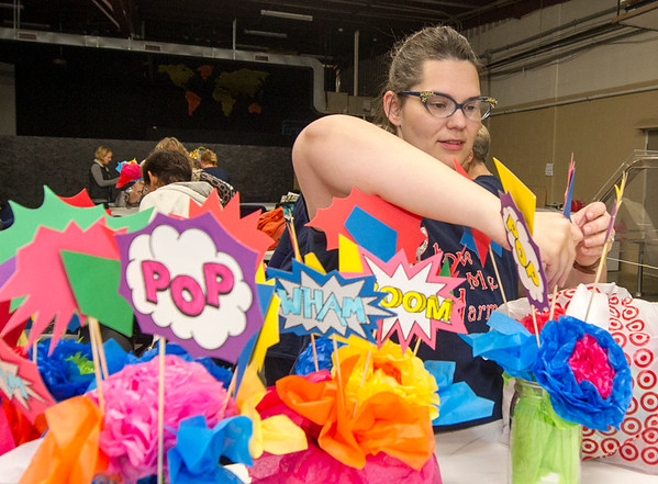 Show-Me Harmony member Heather Hamilton, of Carl Junction,  organizes decorations for an after- performance party on Thursday night before rehearsal at the Joplin Family Worship Center in preparation for their Nov. 12 concert at Ozark Christian College.<br /> Globe | Laurie Sisk