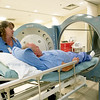 Mercy Clinical Nurse Coordinator Chris Bulita, left, and diabetes patient Jim Cummings demonstrate the use of a hyperbaric chamber on Tuesday at the Mercy Wound Care and Hyperbaric Medicine. Cummings recently received hyperbairc treatment s to heal a diabetes-related wound on his foot.<br /> Globe | Laurie Sisk