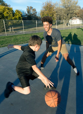 Joplin High School Interact volunteer Dylan Kellar plays a game of one-on-one with Daniel Bryan, 11, last week at the Boys and Girls Club of Southwest Missouri.<br /> Globe | Laurie Sisk