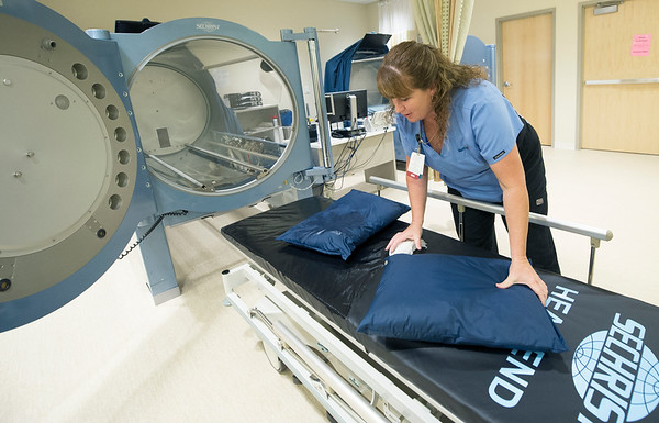 Mercy Clinical Nurse Coordinator Chris Bulita prepares a hyperbaric chamber for its next patient on Tuesday at Mercy Wound Care and Hyperbaric Medicine. <br /> Globe | Laurie Sisk