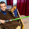 Seven-year-old Peyton Vanderpool poses with his Chewbacca outfit on Wednesday at his Carl Junction home. Peyton and his family recently went on a Make A Wish trip to Universal Studios in Florida, where Peyton was able to meet Star Wars characters.<br /> Globe | Laurie Sisk
