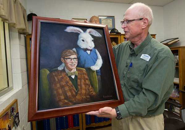"Ozark Christian College Library Director John Hunter holds a portrait painted of himself 47 years ago by Memorial High School classmate PAula Giltner during work on the MHS production of ""Harvey."" The portrait, painted when he was 17, recently found its way back to Hunter.<br /> Globe 