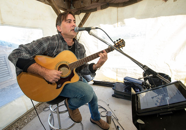 Scott Eastman entertains the crowd with a James Taylor cover on Saturday at the Webb City Farmer's Market.<br /> Globe | Laurie Sisk