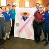 Part of the Joplin Panera Bread Company crew proudly stand beside marketing materials for the company's Pink Ribbon Bagel campaign on Thursday. The local store has repeated as national winners of pink ribbon bagels sold, besting Fort Smith, Ark. for the title.<br /> Globe | Laurie Sisk