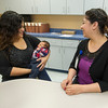 Ruth Guajardo, certified application counselor, visits with Maria Ortega and her one-month-old infant Juan Carlos Espinoza on Tuesday at Access Family Care. Tuesday was the first day of open enrollment for the Affordable Care Act.<br /> Globe | Laurie Sisk