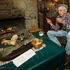 Carthage artist Lowell Davis reflects on his life inside his home - an old slave cabin at Red Oak II - on Tuesday afternoon.<br /> Globe | Laurie Sisk