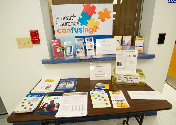 Information on different health care programs, such as Medicare, Medicaid and the Affordable Care Act sit on a table at Access Family Care on Tuesday. Tuesday was the first day of open enrollment for the Affordable Care Act.<br /> Globe | Laurie Sisk