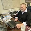 "Carthage Crisis Center Executive Director Jim Benton works on sending ""thank you"" emails to donors of the center on Tuesday. The center relies on donations from the public to run its operations.<br /> Globe 
