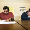 From the left: David Garza and first time voter Yoselyn Garza fill out their ballots during the 2016 General Election on Tuesday at Memorial Auditorium in Carthage.<br /> Globe | Laurie Sisk