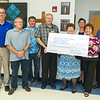 Representatives from Joplin Area Catholic Schools and the Knights of Columbus stand with a $1,500 donation to the Jeff Slama Memorial Scholarship on Wednesday at McAuley High School.<br /> Globe | Laurie Sisk