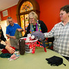 From the left: Suzi Back, Gordon Keyler, Ann Leach and Janell Sitton-Coats, all of Unity of Joplin, sort through some of the scarves they have collected at the church on Monday. Scarves, gloves and hats will be placed throughout the city for those in need to use beginning on Dec. 8. The church hopes to collect about 500 items.<br /> Globe | Laurie Sisk