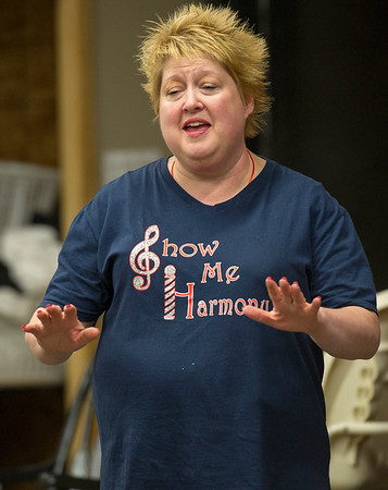 Show-Me Harmony team leader Anne Bryant, of Monett, rehearses with the chorus on Thursday night at the Joplin Family Worship Center in preparation for their Nov. 12 concert at Ozark Christian College.<br /> Globe | Laurie Sisk