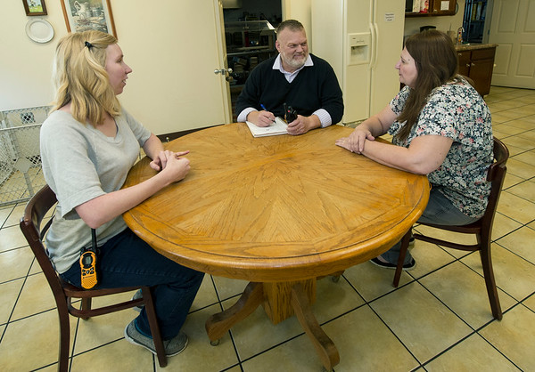 From the left: On Tuesday, Carthage Crisis Center Operations Assistant Brooke Fry, Operations Manager Judy Benton and her husband, Executive Director Jim Benton, plan the Christmas community dinner just days after serving 350 people on Thanksgiving.<br /> Globe | Laurie Sisk