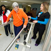 Dr. Rebecca Jeyaseelan, left and Freeman East Occupational Thearapy Assistant Sarah Eitemiller Assist June Morris with rehabilitation inside the Freeman Rehabilitation Unit last week. Morris was rehabbing from arterial bypass surgery on her leg. The unit focuses on rehabilitation in a practical setting, which includes staff assessing patients' abilities to perform everyday activities.<br /> Globe | Laurie Sisk