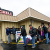 Eager diners don't seem to mind wet weather as they await the re-opening of Fred & Red's on Wednesday.<br /> Globe | Laurie Sisk