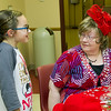 Eight-year-old book lover Briella Parker visits with Webb City Library Director Sue Oliveira at the Webb City Library during a reception for Oliveira on Thursday night. Oliveira  is retiring from the library after 22 years of service.<br /> Globe | Laurie SIsk