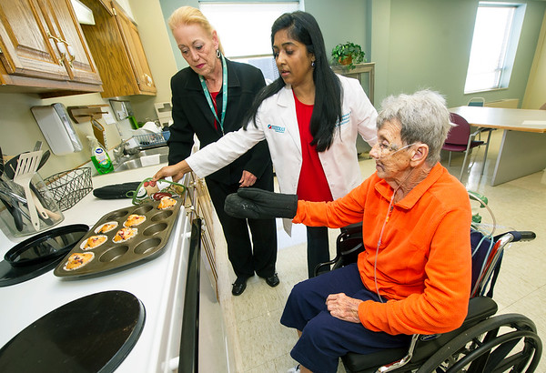 From the left: Caroline DeMott, xxx, and Dr. Rebecca Jeyaseelan help June Morris with rehabilitation in the fully functional kitchen inside the Freeman Rehabilitation Unit last week. Morris was rehabbing from arterial bypass surgery on her leg. The unit focuses on rehabilitation in a practical setting, which includes staff assessing patients' abilities to perform everyday activities.<br /> Globe | Laurie Sisk