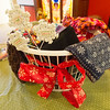 "Scraves collected for the Unity of Joplin ""Chase the Chill"" program sit in a basket at the church on Monday. Scarves, gloves and hats will be placed throughout the city for those in need to use beginning on Dec. 8. The church hopes to collect about 500 items.<br /> Globe 