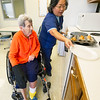 Freeman East Occupational Therapist Eloise Johnston helps June Morris with rehabilitation in the fully functional kitchen inside the Freeman Rehabilitation Unit last week. Morris was rehabbing from arterial bypass surgery on her leg. The unit focuses on rehabilitation in a practical setting, which includes staff assessing patients' abilities to perform everyday activities.<br /> Globe | Laurie Sisk