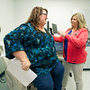 Uninsured patient Lorina Smith visits with Nurse Practitioner Tina Reeves-Hicks on Tuesday at Access Family Care. Tuesday was the first day of open enrollment for the Affordable Care Act.<br /> Globe | Laurie Sisk
