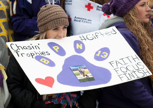 Monett senior Camryn Frank shows her support while still keeping her hands warm as she watches the Cubs win the Class 3 Missouri State Championship on Saturday at Missouri State's Plaster Stadium.<br /> Globe | Laurie Sisk