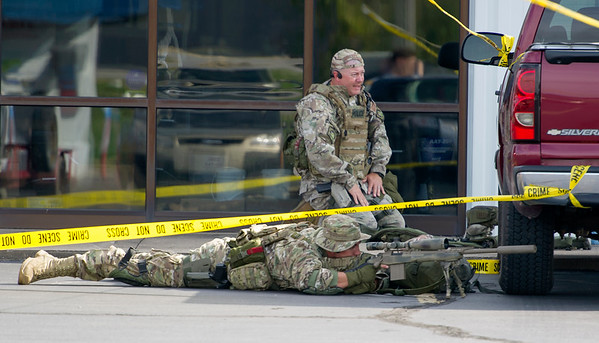 Two Joplin Police SWAT officerswork the perimeter of a scene where they believe a suspect, Don Loomis is hiding at the Motel 6 on Rangeline on Wednesday. The stand-off began about 9 a.m. and continued well into the afternoon hours.<br /> Globe | Laurie Sisk