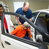 Dr. Rebecca Jeyaseelan, left and Freeman East Program Director for Rehabilitation Jeff Borum help  June Morris into a car inside the Freeman Rehabilitation Unit last week. Morris was rehabbing from arterial bypass surgery on her leg. The unit focuses on rehabilitation in a practical setting, which includes staff assessing patients' abilities to perform everyday activities.<br /> Globe | Laurie Sisk
