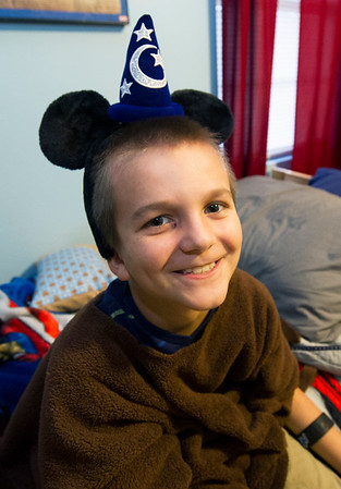 At his Carl Junction home on Wednesday, seven-year-old Peyton Vanderpool dons the Mickey Mouse ears he received during his Make A Wish visit to the Magic Kingdom.<br /> Globe | Laurie Sisk