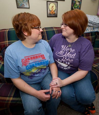 Kris Hartley, left and Jennifer Howell pose for a photo in their Duquesne home last week. The couple were recently married in Eureka Springs, Ark. and are concerned how they will be affected by the new administration.<br /> Globe | Laurie Sisk
