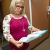 Freeman RN Janice Drake, program coordinator for the Freeman Bariatric Center, holds an informational brouchure about bariatric surgery on Wednesday at the center. <br /> Globe | Laurie Sisk