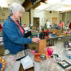 Carol Albertson, of Baxter Springs, Kan., looks through items for sale at the Wildcat Glades Rummage Sale on Friday at the Wildcat Glades Conservation and Audubon Center. The sale continues from 9 a.m. to 5 p.m. on Saturday. After 3 p.m., guests may feel a bag full of items for $2.<br /> Globe | Laurie Sisk