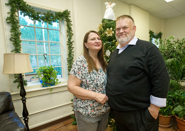 Carthage Crisis Center Operations Director Judy Benton and her husband, Executive Director Jim Benton, stand in the decorated lobby of the center on Tuesday. The couple will soon celebrate their first anniversary running the center.<br /> Globe | Laurie Sisk