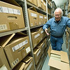 Steve Weldon, director of the Jasper County Records Center, stands among the many stacks of historic artifacts and documents housed at the center on Monday.<br /> Globe | Laurie Sisk