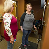 Freeman RN Janice Drake, program coordinator for the Freeman Bariatric Center, weighs in post-surgery patient and co-worker, Rebecca Wilkinson on Wednesday at the center. Wilkinson, a CMA at the center, has lost 85 lbs. since her surgery.<br /> Globe | Laurie Sisk